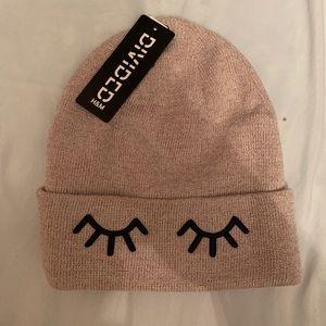 pink beanie with eyelashes